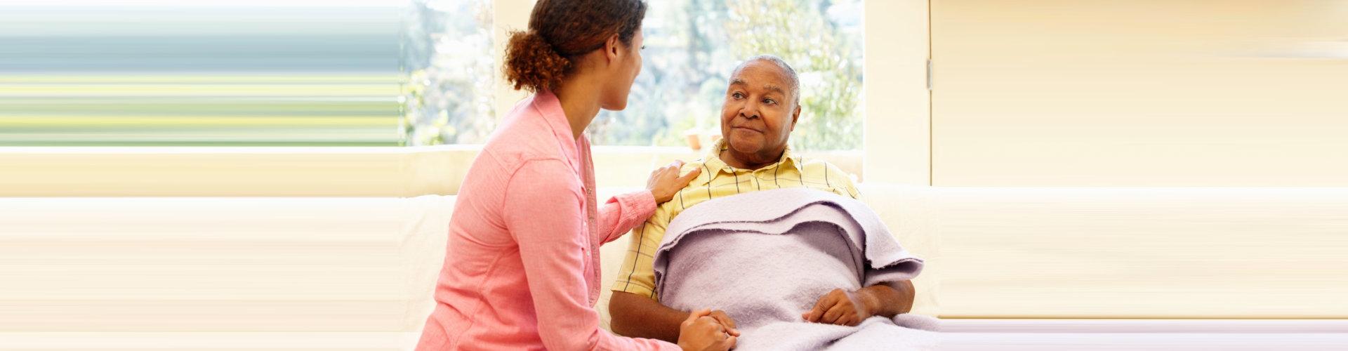 woman talking to senior man